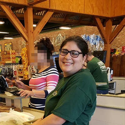 Candice working at Sprouts Family Market.